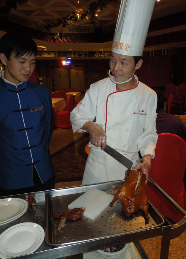 Chef preparing Peking Duck.
